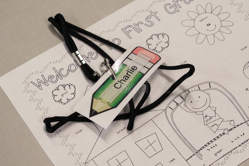 A name tag and welcome coloring page await the arrival of a student royalty free stock photo