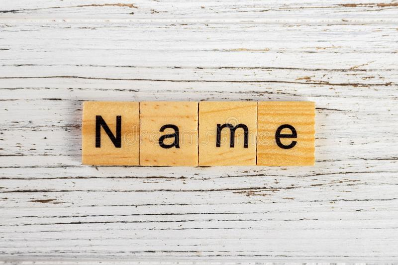 NAME word made with wooden blocks concept.  stock photos