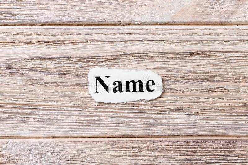 Name of the word on paper. concept. Words of name on a wooden background.  royalty free stock image