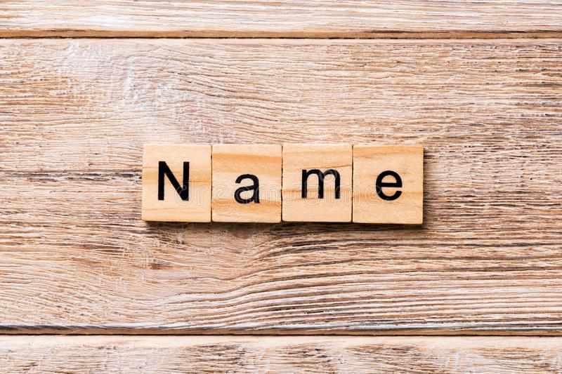 NAME word written on wood block. NAME text on wooden table for your desing, concept.  royalty free stock photos