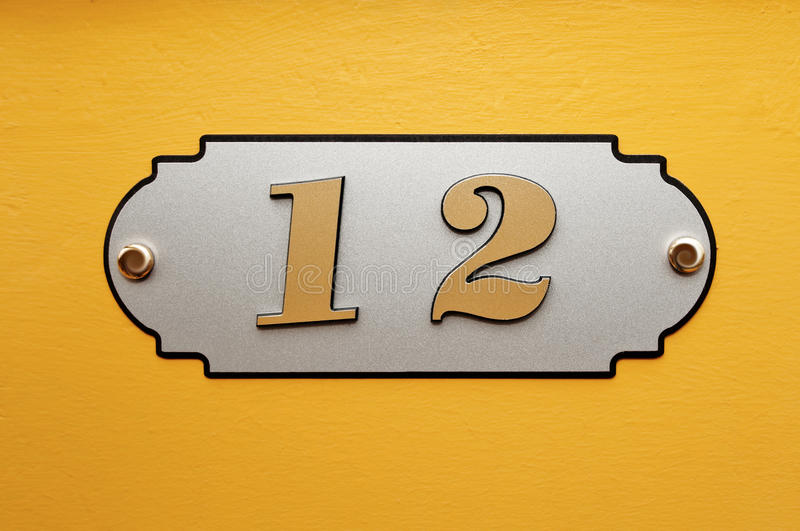Nameboard sign background. Background yellow building number plate and the number of flags stock photo