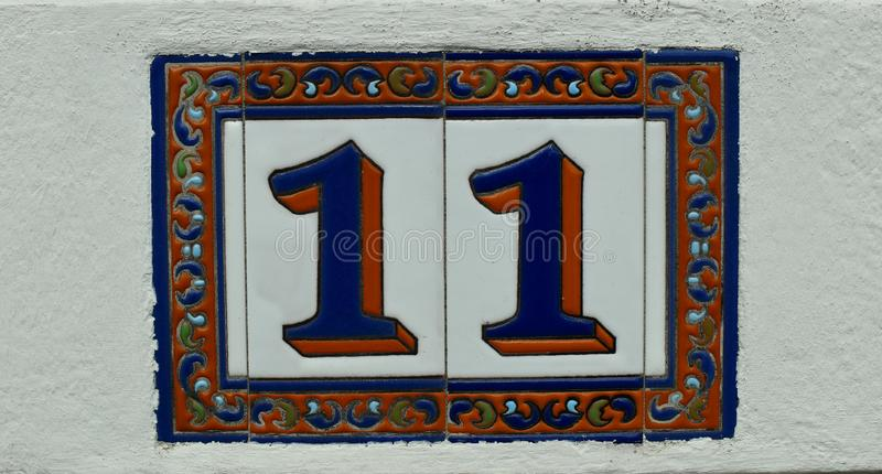 Named ceramic plate with the house number. Fragment of a building with a window.Evangelical church.St. Paul`s Church in Bünde.Germany. church.St. Paul`s stock image