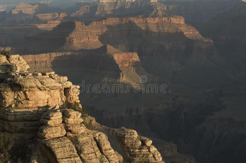 Early morning light creeps creeps cross the Grand Canyon. Named a UNESCO World Heritage Site in 1979, the Grand Canyon National Park is located in northwestern stock image