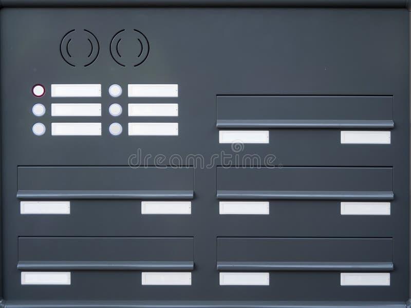 Nameplates почтовых ящиков и кнопки колокола стоковое изображение