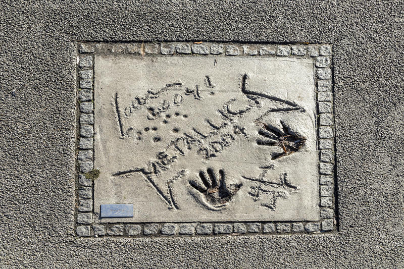 Names and hand prints of stars at the Munich walk of fame in the. MUNICH, GERMANY - NOV 28, 2016: names and hand prints of stars at the Munich walk of fame in stock photography