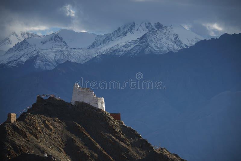 Namgyal Tsemo Gompa from behind and snow mountain range background Leh, Ladakh, India. royalty free stock image