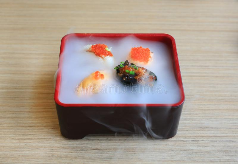 Nami sushi set served with cold smoked on wooden table. Traditional Japanese food.  royalty free stock photo