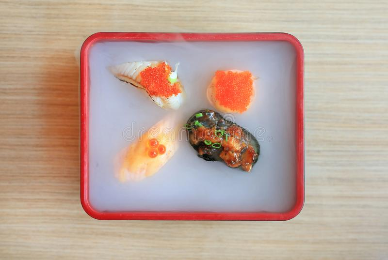 Nami sushi set served with cold smoked on wooden table. Traditional Japanese food.  royalty free stock photography