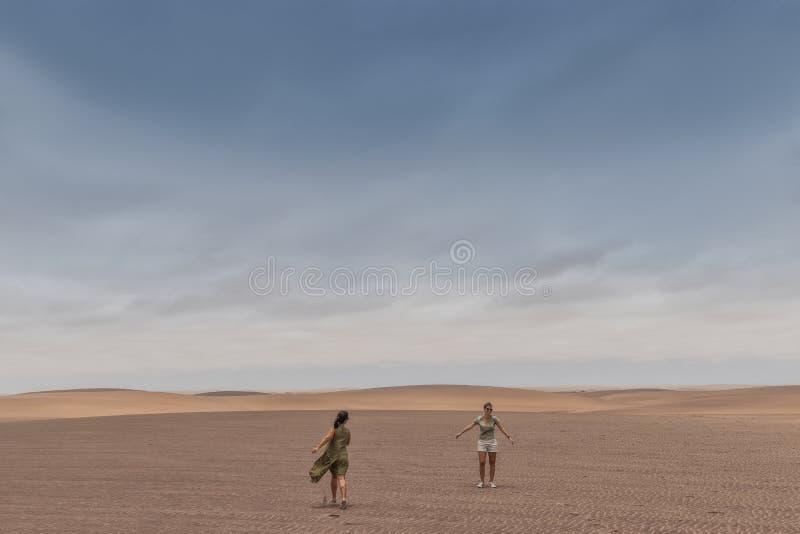 NAMIBE/ANGOLA - 03NOV2018 - girls walking in the desert of Namibe. Africa. Angola stock photography