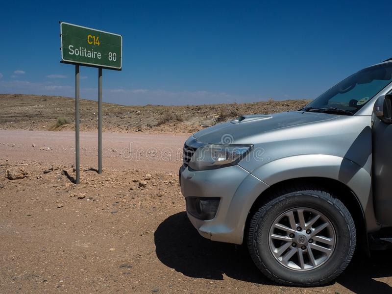 Namibia - November 30, 2016: Adventure road trip through rock mountain landscape via route C14 to Solitaire with Toyota Fortuner stock photography