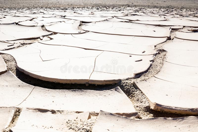 Namibia parched earth landscale. Namibia landscape, Damaraland parched cracked earth after the rain royalty free stock photos