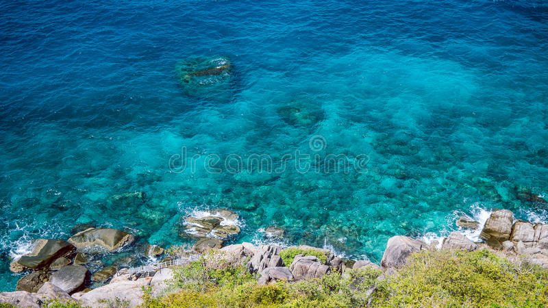 Nangyuan island, West Side, Clear Blue Water Hitting Rocks, Thailand. Nangyuan island, West Side of the Twin Peaks Island, Clear Blue Water Hitting Rocks royalty free stock photo