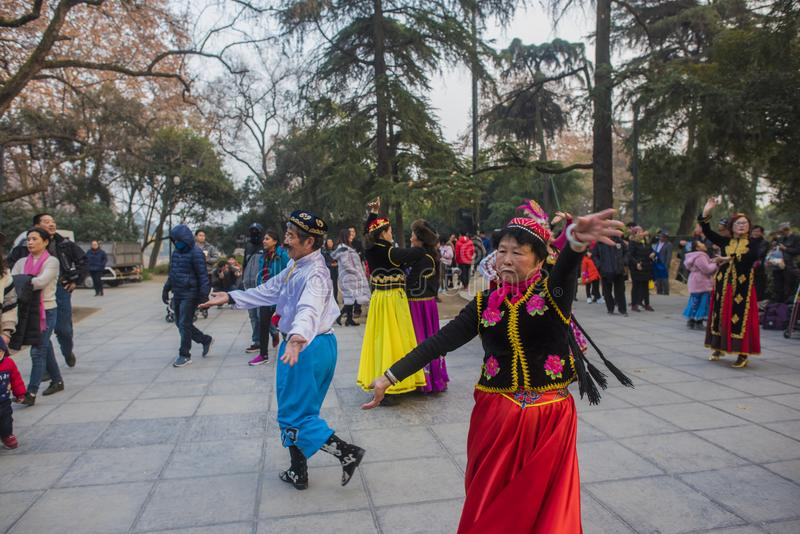 In nanjing xuanwu lake park in jiangsu province, there is a group of people who are fond of xinjiang dance, often dancing happily stock photography