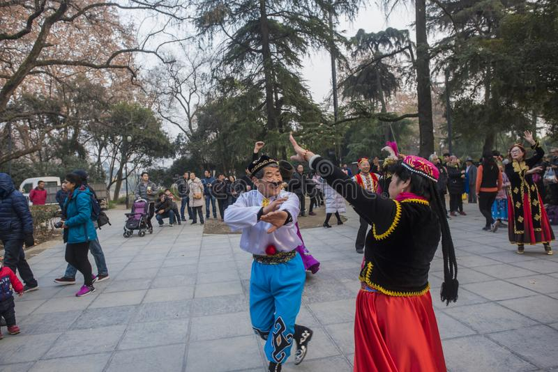 In nanjing xuanwu lake park in jiangsu province, there is a group of people who are fond of xinjiang dance, often dancing happily royalty free stock images