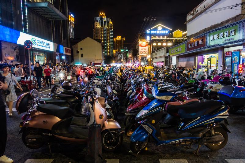 NANNING, CHINA August 2018: Mopeds Lined Up on Street in Chinese. City with Most Mopeds in China royalty free stock image