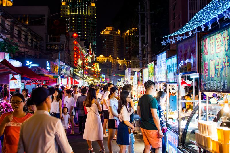 NANNING, CHINA - JUNE 9, 2017: Nanning Zhongshan Snack Street wi. Th many people bying food and walking around. This food street is the biggest night food market royalty free stock photos