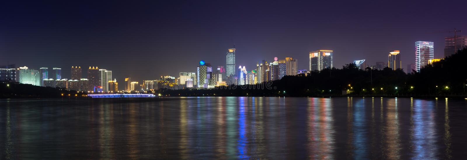 NANNING, CHINA - SEPTEMBER 18: View at the modern business city. Area with high buildings reflecting in the Nanhu lake. Nanning is the capital city of Guangxi stock photos