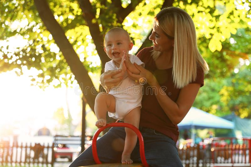Nanny and cute baby sitting on  outdoors royalty free stock photography