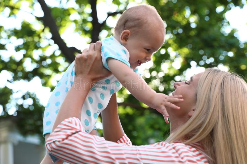 Nanny with cute baby on sunny day. Nanny with cute baby outdoors on sunny day royalty free stock images