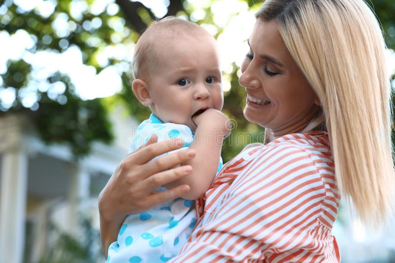 Nanny with cute baby  on sunny day royalty free stock image