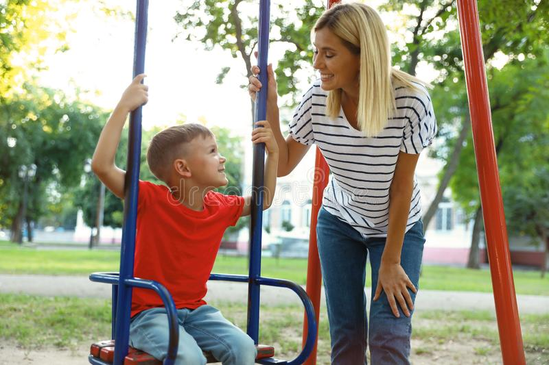 Nanny and cute little boy on  in park stock photo