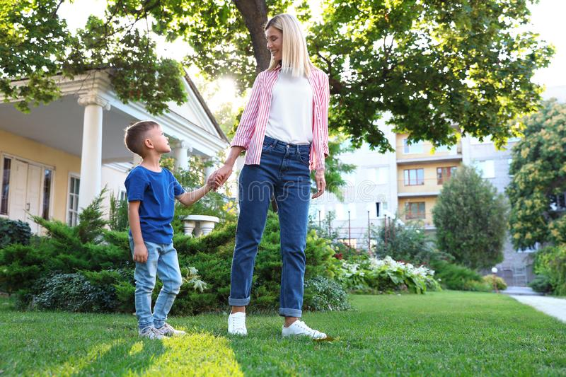 Nanny with cute little boy  on sunny day. Space for text. Nanny with cute little boy together on sunny day. Space for text royalty free stock photos