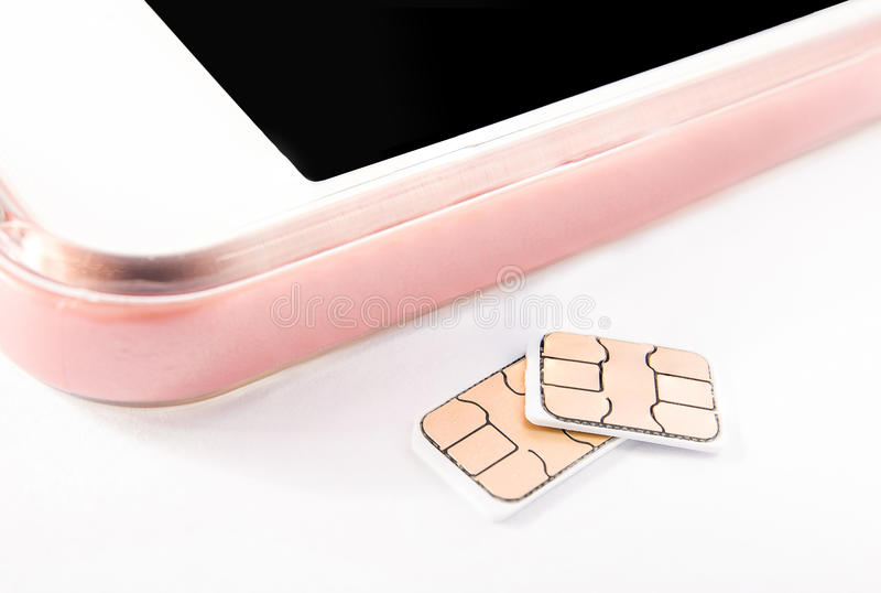 Nano sim card and smart phone royalty free stock photos