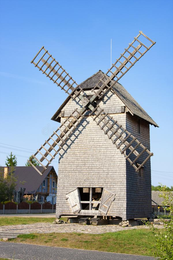 Windmill in ethnocultural complex Nanosy-Novoselye. Nanosy, Belarus - August 24, 2018: Windmill in ethnocultural complex Nanosy-Novoselye. It is historical stock images