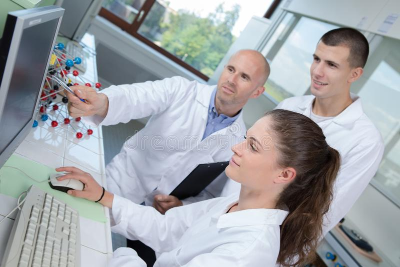 Nanotechnology interns in laboratory royalty free stock images