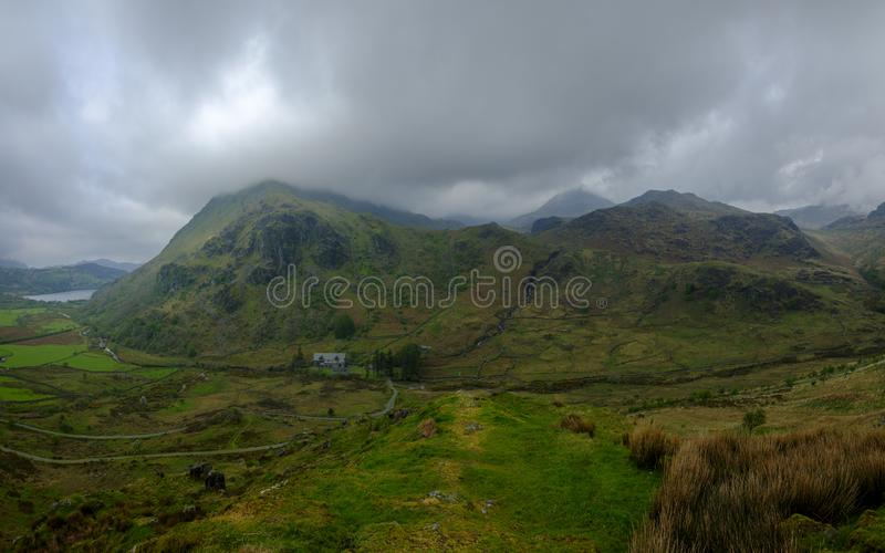 He view towards Snowdon from the A498 viewpoint climbing up to Pen-Y-Pass, Wales. Nant Gwynant, Wales - May 1, 2019:  The view towards Snowdon from the A498 royalty free stock image