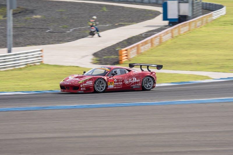 Naoki Yokomizo die van Richting in Super Definitieve Race 66 van GT Overlapping rennen stock fotografie