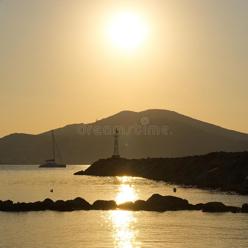 Naoussa village and harbor at sunset - Aegean Sea - Paros Cyclades island - Greece stock photography
