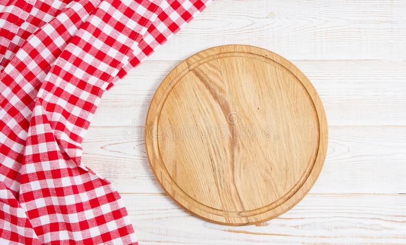 Napkin and board for pizza on wooden desk closeup, tablecloth. Canvas, dish towels on white wooden table background top view mock royalty free stock images
