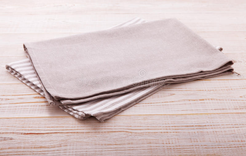 Napkin. Cloth napkin on white wooden table . Perspective, mockup. stock photos