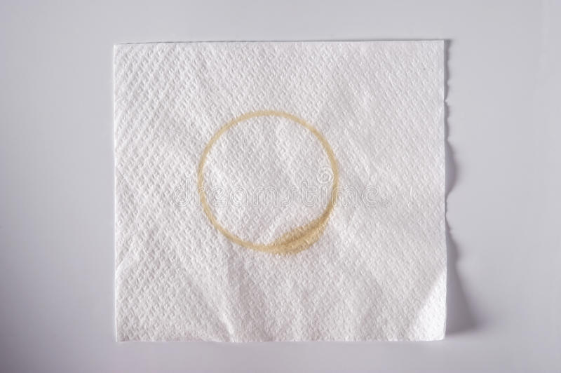 Napkin with a coffee stain royalty free stock photos
