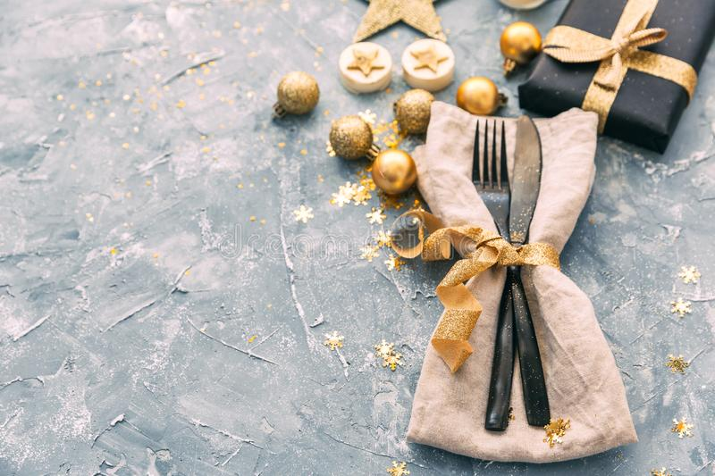Napkin, fork and knife over vintage background. Happy new Year dinner. stock photo