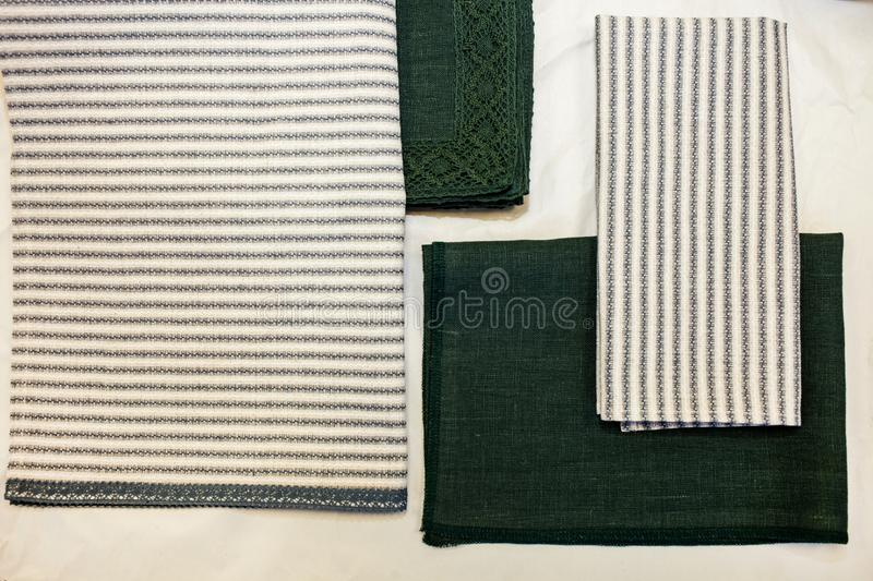 Napkins green and white blue linen. Textile manufacture stock images
