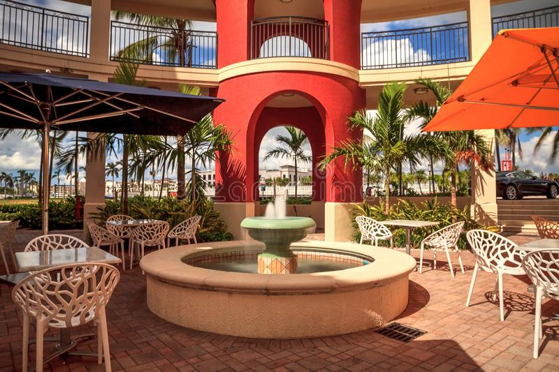 Long exposure of a colorful building with a fountain. Naples, Florida, USA – October 20, 2017: Long exposure of a colorful building with a fountain in stock image