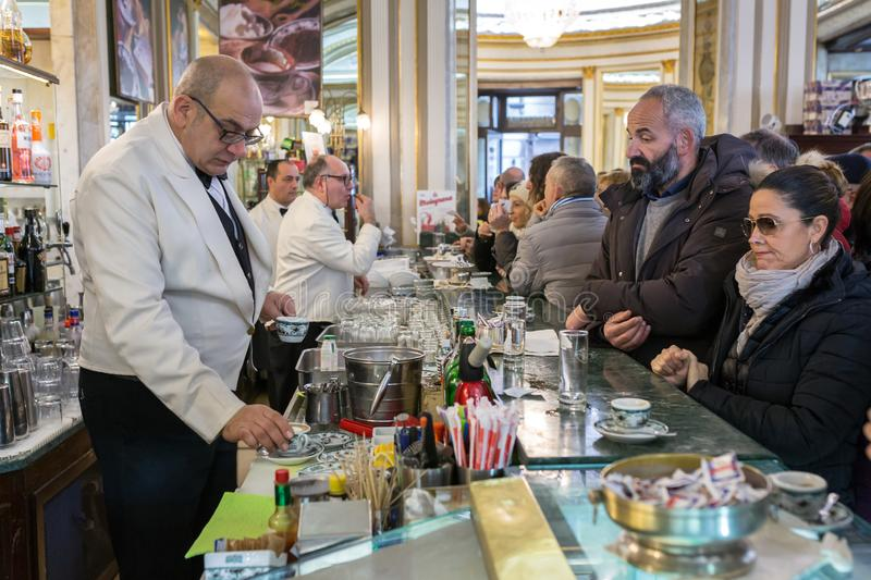 Unidentified people visiting famous italian cafe Gambrinus. Naples, Italy - December 3, 2017: Unidentified people visiting famous italian cafe Gambrinus. It is a royalty free stock photography