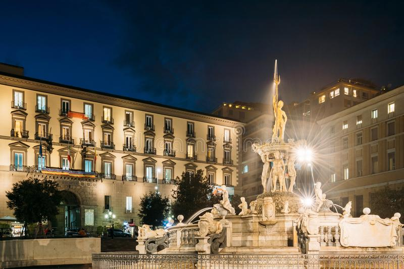Naples, Italy. Fountain Of Neptune On Piazza Municipio In Evening Or Night Illuminations stock photography