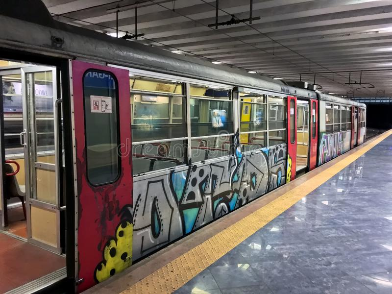Metro Car in Naples, Italy, Europe. Naples, Italy - July 23, 2018: Metro car covered in graffiti stock photography