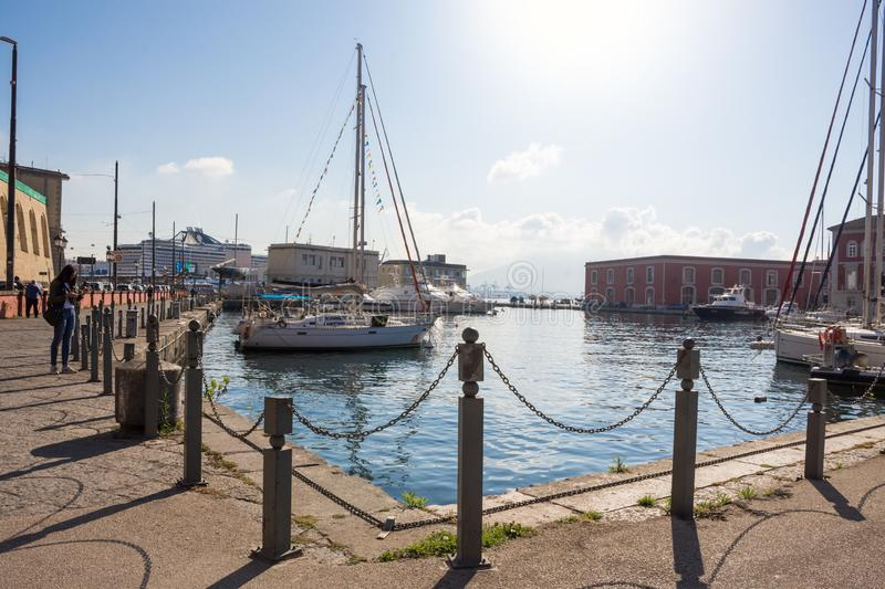 NAPLES, ITALY - MAY 2, 2019: Sea port of city of Naples with small fishing boats on water in Napoli stock photo