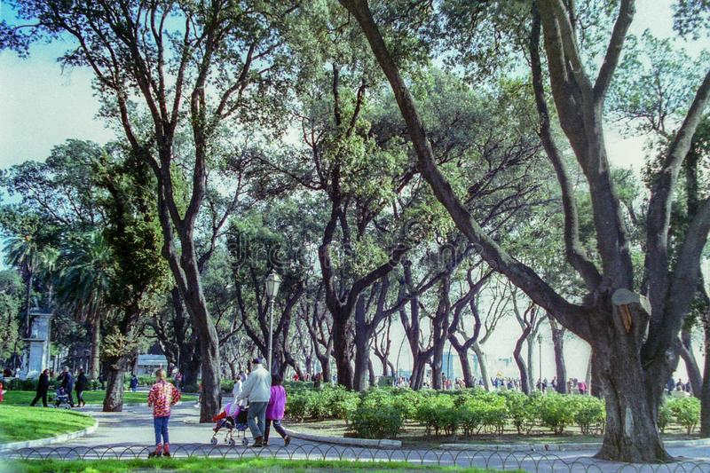 NAPLES, ITALY, 1995 - The monumental trees of the Villa Comunale in Naples offer shade to tourists and Neapolitans.  stock photos