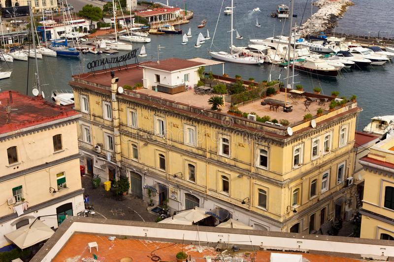 NAPLES, ITALY - OCTOBER 31, 2015: Air view of the old historical buildings of Naples with a recreation area on the roof of one of stock photography