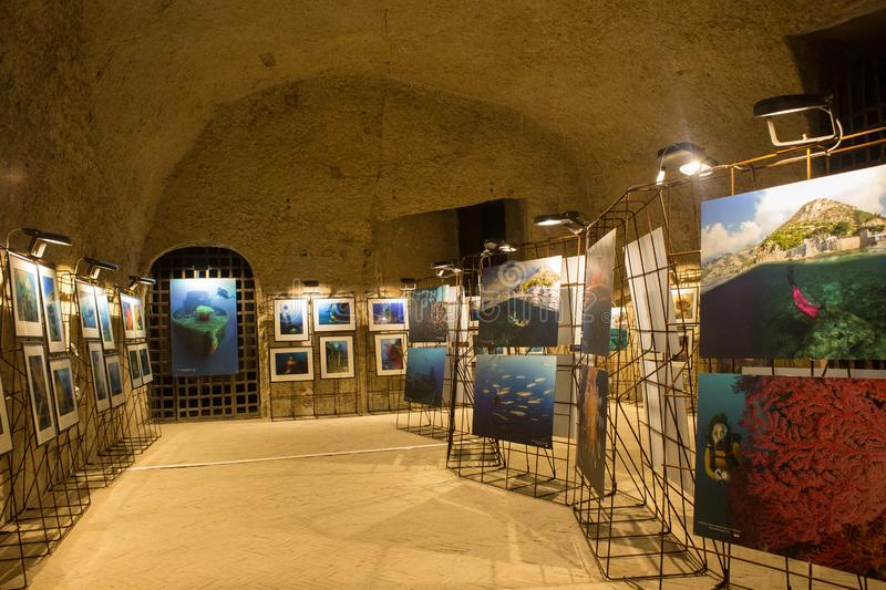 NAPLES, ITALY - OCTOBER 31, 2015: Local photo exhibition in the medieval castle Castel dell`Ovo. The Castel dell`Ovo is the olde royalty free stock image
