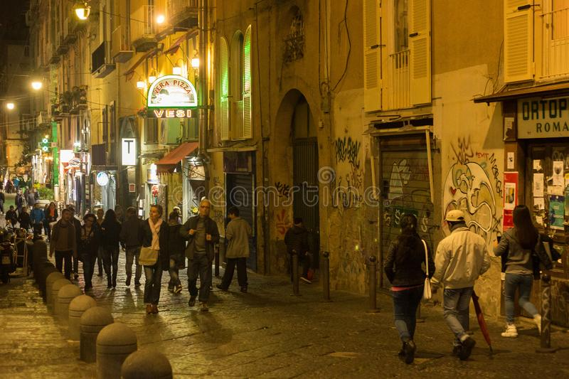 NAPLES, ITALY - OCTOBER 31, 2015: Unknown people on the one of the old shabby narrow streets in the historical part of Naples at stock images