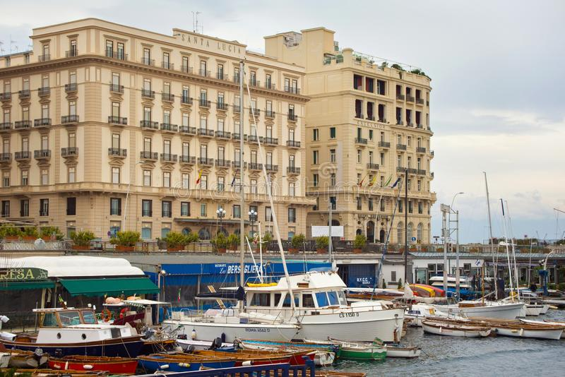 NAPLES, ITALY - OCTOBER 31, 2015: View of the Grand Hotel Santa Lucia and Hotel Excelsior in historical center of Naples near gulf royalty free stock photography