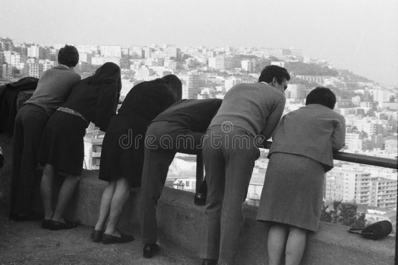 NAPLES, ITALY, 1969 - Three young couples admire the panorama of Naples from Via Orazio royalty free stock images