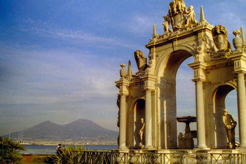 NAPLES, ITALY, 1995 - Vesuvius is the backdrop to the monumental Fontana del Gigante located on the Naples waterfront.  royalty free stock images