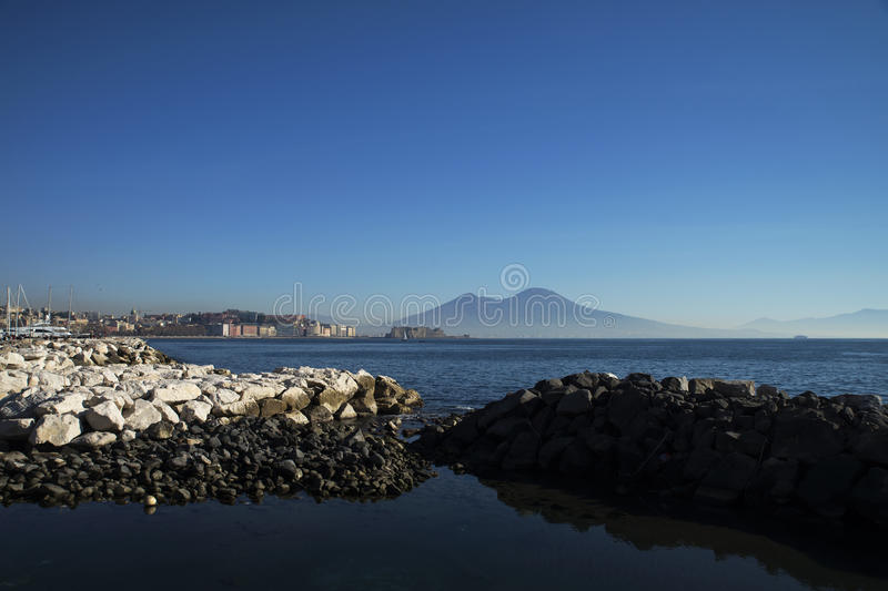 Naples And Mt. Vesuvius. From the perspective of the water, the view of the shore line of Naples, Italy, and Mt. Vesuvius in the distance. 26/12/2016 royalty free stock photos